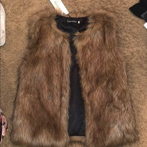 New with tags faux fur vest